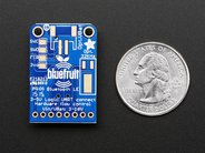 Adafruit Bluefruit LE UART Friend reverse, shown with quarter for scale
